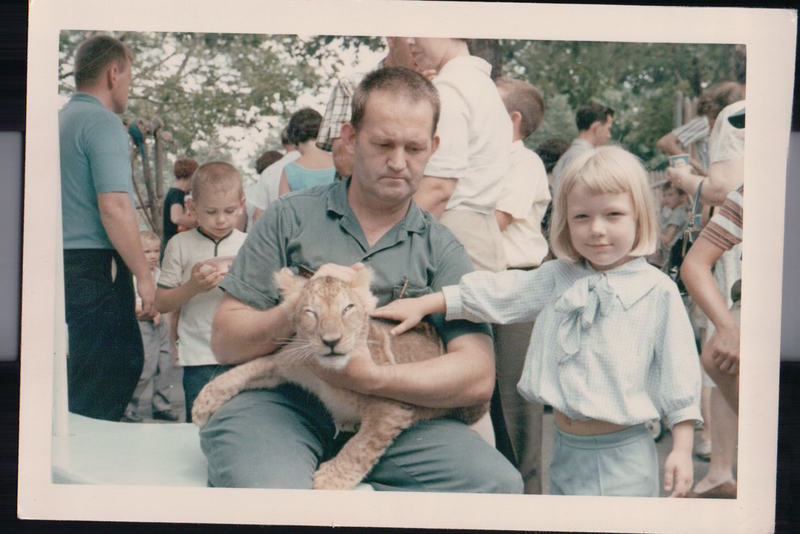 Mom petting a lion cub at the Cincinnati Zoo c 1964