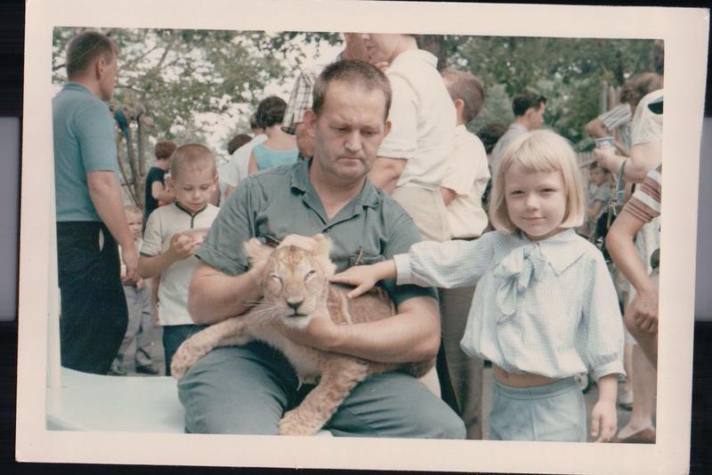 Mom petting a lion cub at the Cincinnati Zoo c 1964