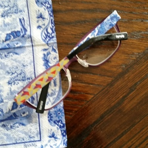I've started decopaging a pair of my readers in the pattern...too far?