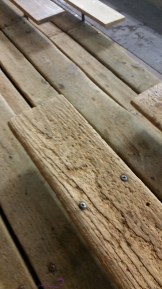 Bleachers made from well worn boards at an indoor hockey rink