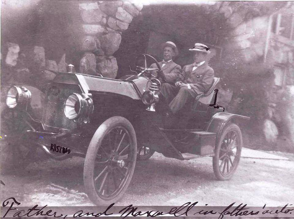 The owner/developer of Golden Hill with his son in a Parry Motor Car